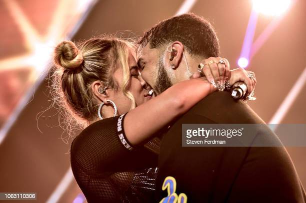 Karol G and Anuel AA kiss live on stage during Anuel AA Karol G In Concert at United Palace Theater on November 17 2018 in New York City