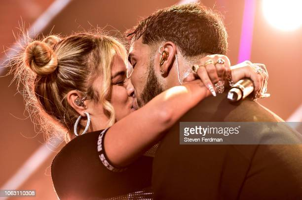 Karol G and Anuel AA kiss live on stage during their concert at United Palace Theater on November 17 2018 in New York City