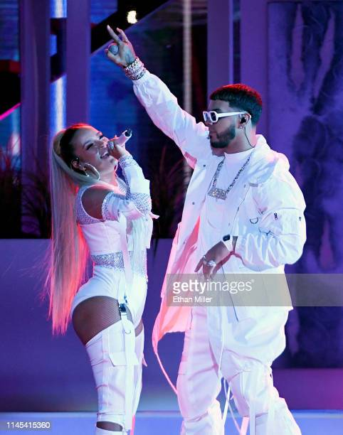 Karol G and Anuel AA perform during the 2019 Billboard Latin Music Awards at the Mandalay Bay Events Center on April 25 2019 in Las Vegas Nevada