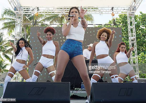 Karol G is seen performing on stage during Copa America Fieston on June 4 2016 in Miami Beach Florida