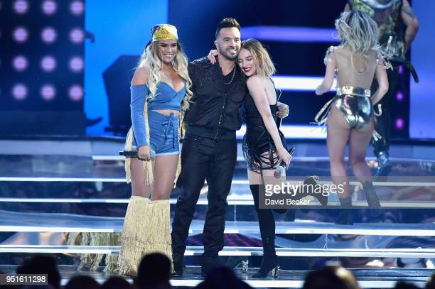 Karol G Luis Fonsi and Paty Cantu perform onstage at the 2018 Billboard Latin Music Awards at the Mandalay Bay Events Center on April 26 2018 in Las...