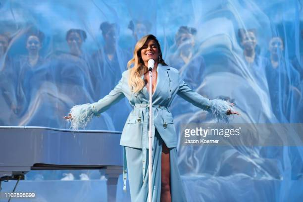 Karol G performs on stage during Premios Juventud 2019 at Watsco Center on July 18 2019 in Coral Gables Florida