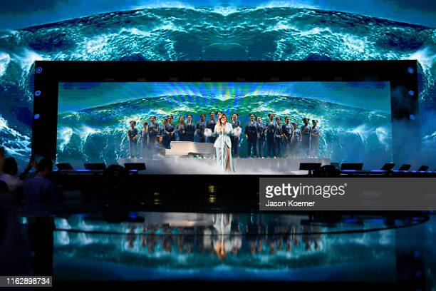 Karol G performs on stage during Premios Juventud 2019 at Watsco Center on July 18, 2019 in Coral Gables, Florida.