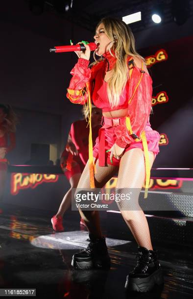 Karol G performs on stage during the new makeup line launch Pretty Different by Urban Decay at Galeria Luis Adelantado on August 15 2019 in Mexico...
