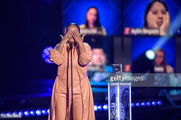 Karol G receives an award onstage during Premios Juventud 2020 at the Hard Rock Live! in the Seminole Hard Rock Hotel & Casino on August 9, 2020 in...
