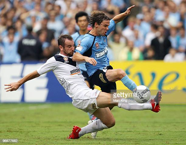 Karol Kisel of Sydney is challenged by Grant Brebner of the Victory during the round 27 A-League match between Sydney FC and the Melbourne Victory at...