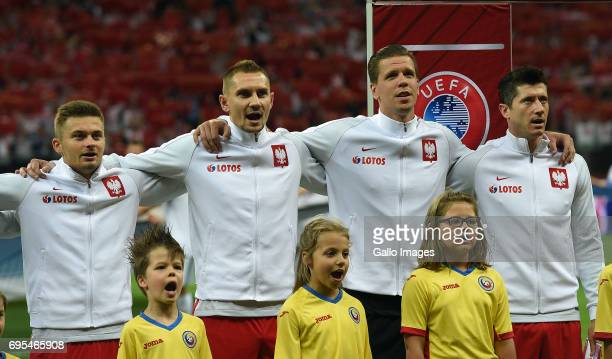 Karol Linetty Artur Jedrzejczyk Wojciech Szczesny and Robert Lewandowski of Poland line up during the 2018 FIFA World Cup Russia eliminations match...