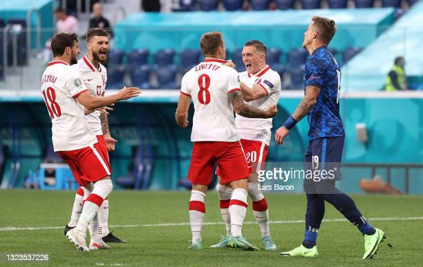Karol Linetty of Poland celebrates with Piotr Zielinski after scoring their side's first goal during the UEFA Euro 2020 Championship Group E match...