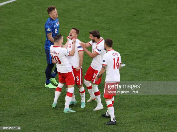Karol Linetty of Poland celebrates with Piotr Zielinski and team mates after scoring their side's first goal during the UEFA Euro 2020 Championship...