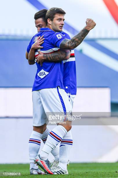 Karol Linetty of Sampdoria celebrates with his team-mate Andrea Bertolacci after scoring a goal during the Serie A match between UC Sampdoria and...