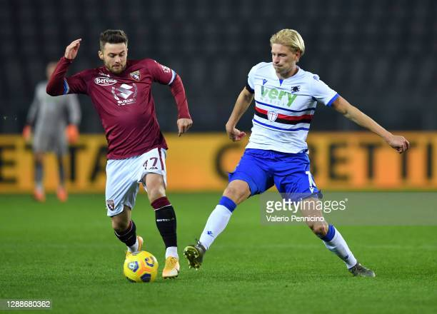 Karol Linetty of Torino F.C. Battles for possession with Morten Thorsby of U.C. Sampdoria during the Serie A match between Torino FC and UC Sampdoria...