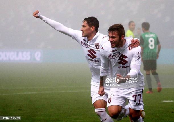 Karol Linetty of Torino FC celebrates with his team mates Sasa Lukic after scoring his goal during the Serie A match between US Sassuolo and Torino...