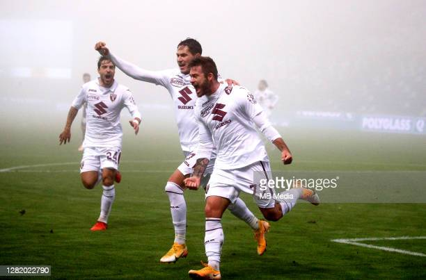 Karol Linetty of Torino FC celebrates with his team mates Sasa Lukic and Simone Verdi after scoring his goal during the Serie A match between US...