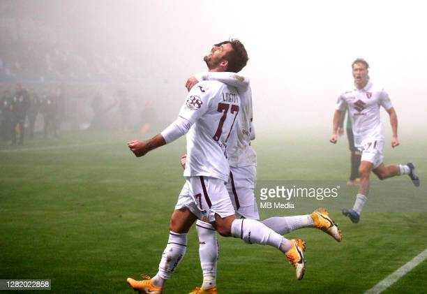 Karol Linetty of Torino FC celebrates with his team mates Sasa Lukic and Mergim Vojvoda after scoring his goal during the Serie A match between US...
