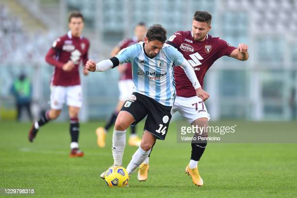 Karol Linetty of Torino FC competes with Cassio Cardoselli of Virtus Entella during the Coppa Italia match between Torino FC and Virtus Entella at...