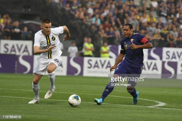 Karol Mets of AIK and Marcos Tavares of Maribor in action during the Second qualifying round of the UEFA Champions League between NK Maribor and AIK...