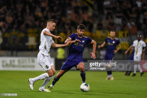 Karol Mets of AIK and Rok Kronaveter of Maribor in action during the Second qualifying round of the UEFA Champions League between NK Maribor and AIK...