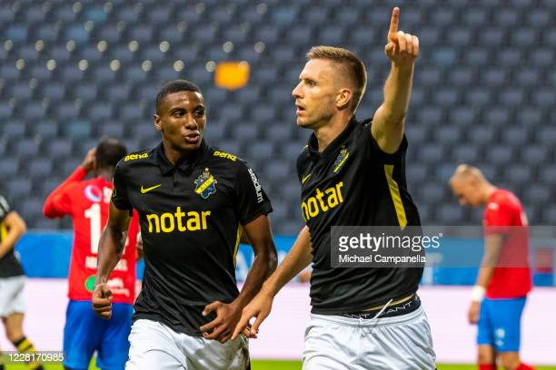 Karol Mets of AIK celebrates scoring the 2-0 goal with teammate Paulos Abraham during an Allsvenskan match between AIK and Helsingborgs IF at Friends...