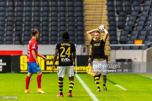 Karol Mets of AIK takes a throw in during an Allsvenskan match between AIK and Helsingborgs IF at Friends Arena on August 23, 2020 in Stockholm,...