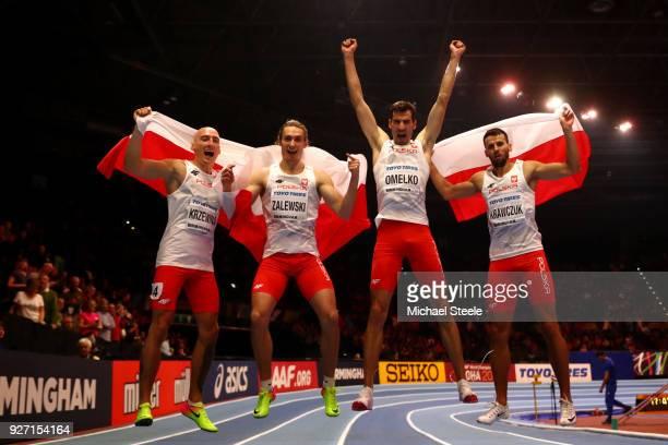 Karol Zalewski Rafal Omelko Lukasz Krawczuk and Jakub Krzewina of Poland celebrate winning the Men's 4 x 400 Metres Relay Final during the IAAF World...