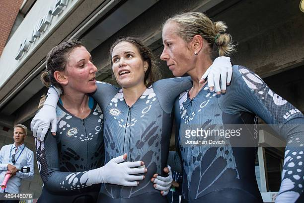 KarolAnn Canuel riding for the VelocioSRAM team is helped to her feet by teammates Trixi Worrack and Lisa Brennauer after her hard effort to help win...
