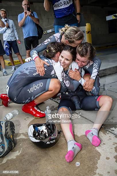 KarolAnn Canuel riding for the VelocioSRAM team is hugged by teammates Trixi Worrack Alena Amialiusik Lisa Brennauer after winning the women's team...