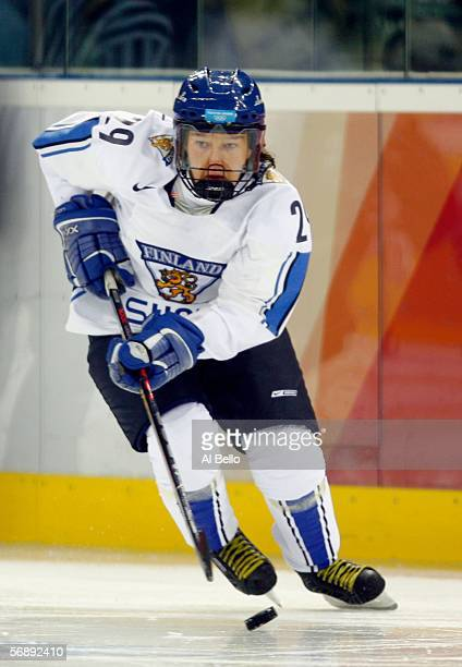Karoliina Rantamaki of Finland controls the puck during the women's ice hockey bronze medal match against the United States during Day 10 of the...