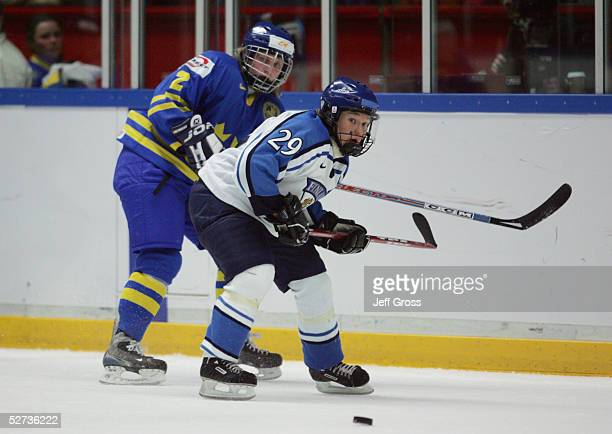 Karoliina Rantamaki of team Finland battles for the puck with Elin Holmlov of team Sweden during the IIHF World Women's Championships bronze medal...
