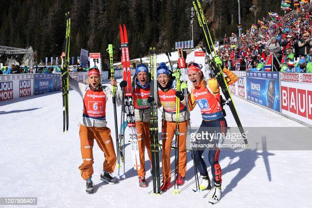 Karolin Horchler of Germany an team mates Vanessa Hinz, Franziska Preuss and Denise Herrmann celebrate winning the 2nd place after the Women 4x6 km...