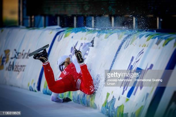 Karolina Bosiek of Poland crashes in the Ladies Mass Start during day 3 of the ISU World Junior Speed Skating Championships Baselga Di Pine at Ice...