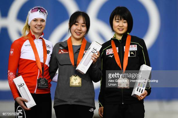 Karolina Bosiek of Poland JiWoo Park of Korea and Karuna Koyama of Japan stand on the podium after the ladies 1500 meter final during day 3 of the...