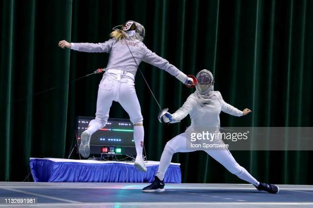 Karolina Cieslar of St John's and Zara Moss of Penn State compete in the championship bout in Women's Saber at the National Collegiate Fencing...