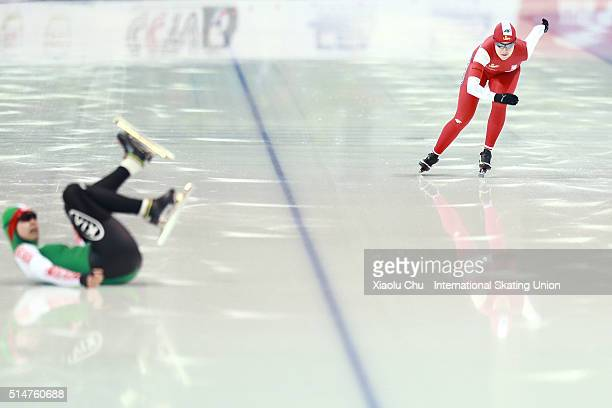 Karolina Gasecka of Poland competes in the Ladies 500m while Yevgenya Vorobyova of Belarus crashes on day one of the ISU Junior Speed Skating...