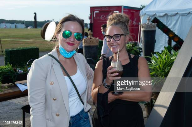 Karolina Girasole and Andrea Correale attend the Hamptons Magazine x The Chainsmokers VIP Dinner at The Barn at Nova's Ark on July 25, 2020 in...