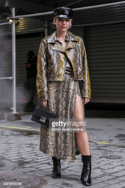 Karolina is seen wearing a Zara dress and jacket black shoes from TopShop and a bag from Sabrina Pilewicz on the street during New York Fashion Week...