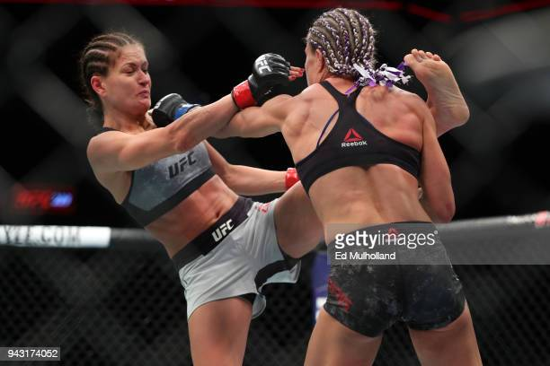 Karolina Kowalkiewicz lands a kick on Felice Herrig during their strawweight bout at UFC 223 at Barclays Center on April 7 2018 in New York City