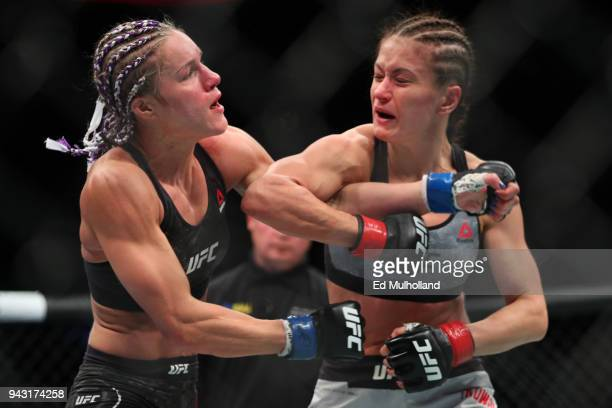 Karolina Kowalkiewicz lands an elbow on Felice Herrig during their strawweight bout at UFC 223 at Barclays Center on April 7 2018 in New York City
