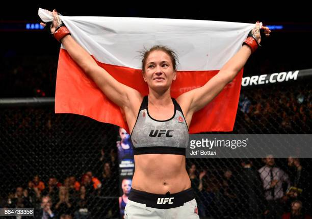Karolina Kowalkiewicz of Poland celebrates after her victory over Jodie Esquibel in their women's strawweight bout during the UFC Fight Night event...