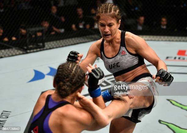 Karolina Kowalkiewicz of Poland kicks Jodie Esquibel in their women's strawweight bout during the UFC Fight Night event inside Ergo Arena on October...