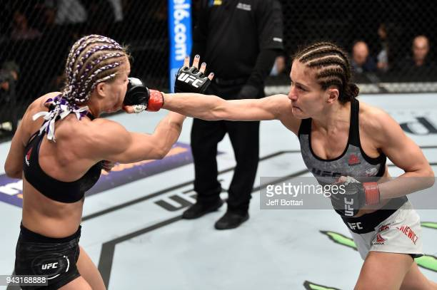 Karolina Kowalkiewicz of Poland punches Felice Herrig in their women's strawweight bout during the UFC 223 event inside Barclays Center on April 7...