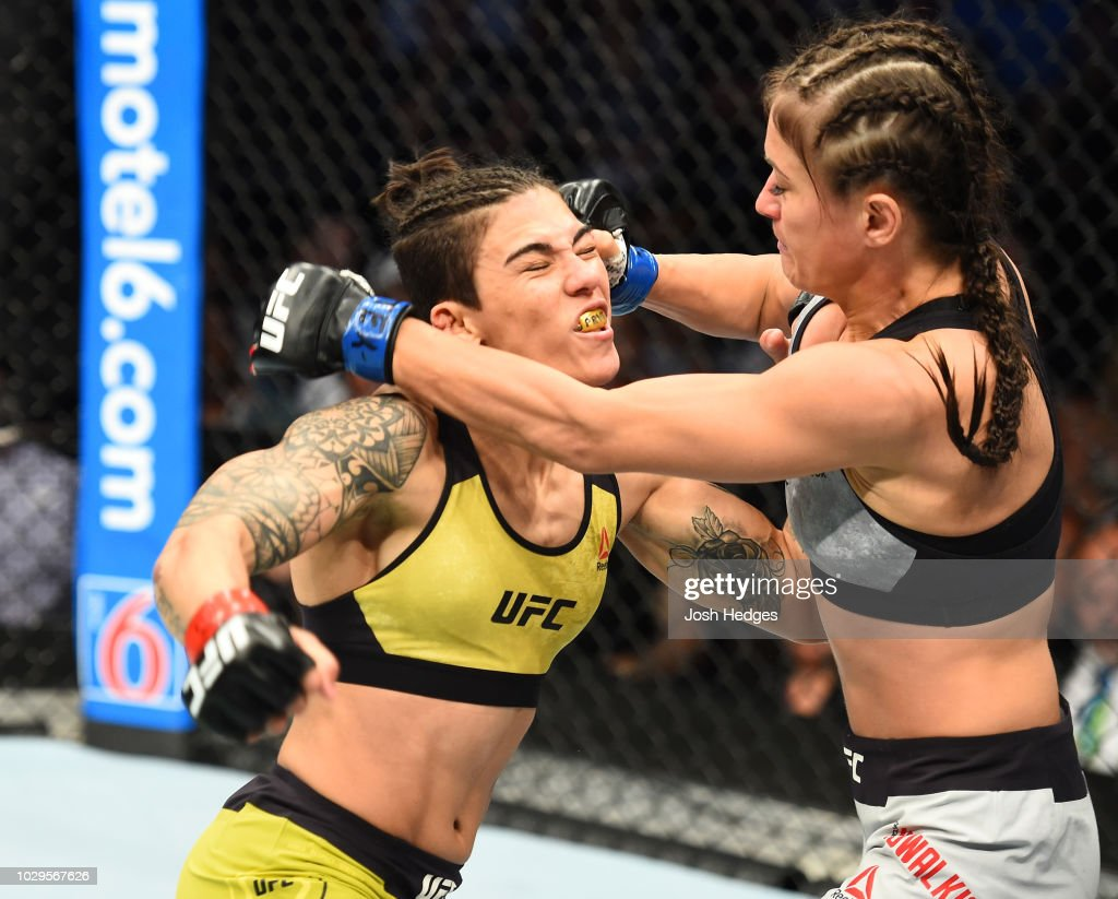 Karolina Kowalkiewicz of Poland punches Jessica Andrade of Brazil in their women's strawweight fight during the UFC 228 event at American Airlines Center on September 8, 2018 in Dallas, Texas.