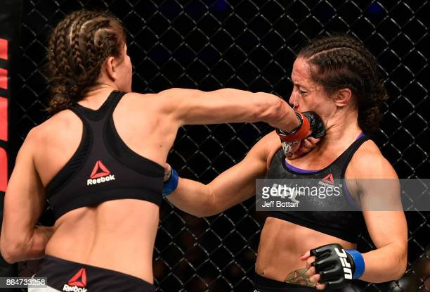 Karolina Kowalkiewicz of Poland punches Jodie Esquibel in their women's strawweight bout during the UFC Fight Night event inside Ergo Arena on...