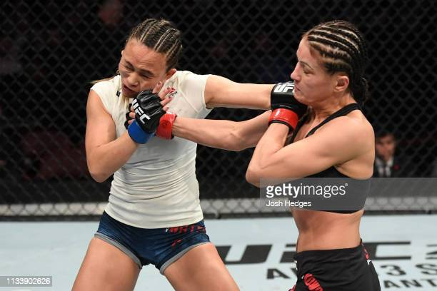 Karolina Kowalkiewicz of Poland punches Michelle Waterson in their women's strawweight bout during the UFC Fight Night Event event at Wells Fargo...