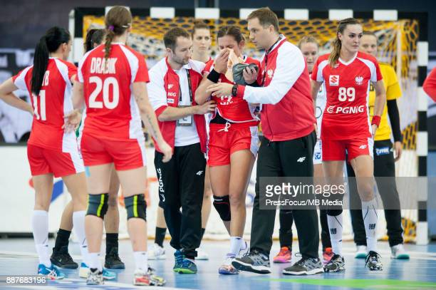 Karolina KudlaczGloc of Poland got hit by Anett Kisfaludy of Hungary fainted and needed medical assistance during IHF Women's Handball World...