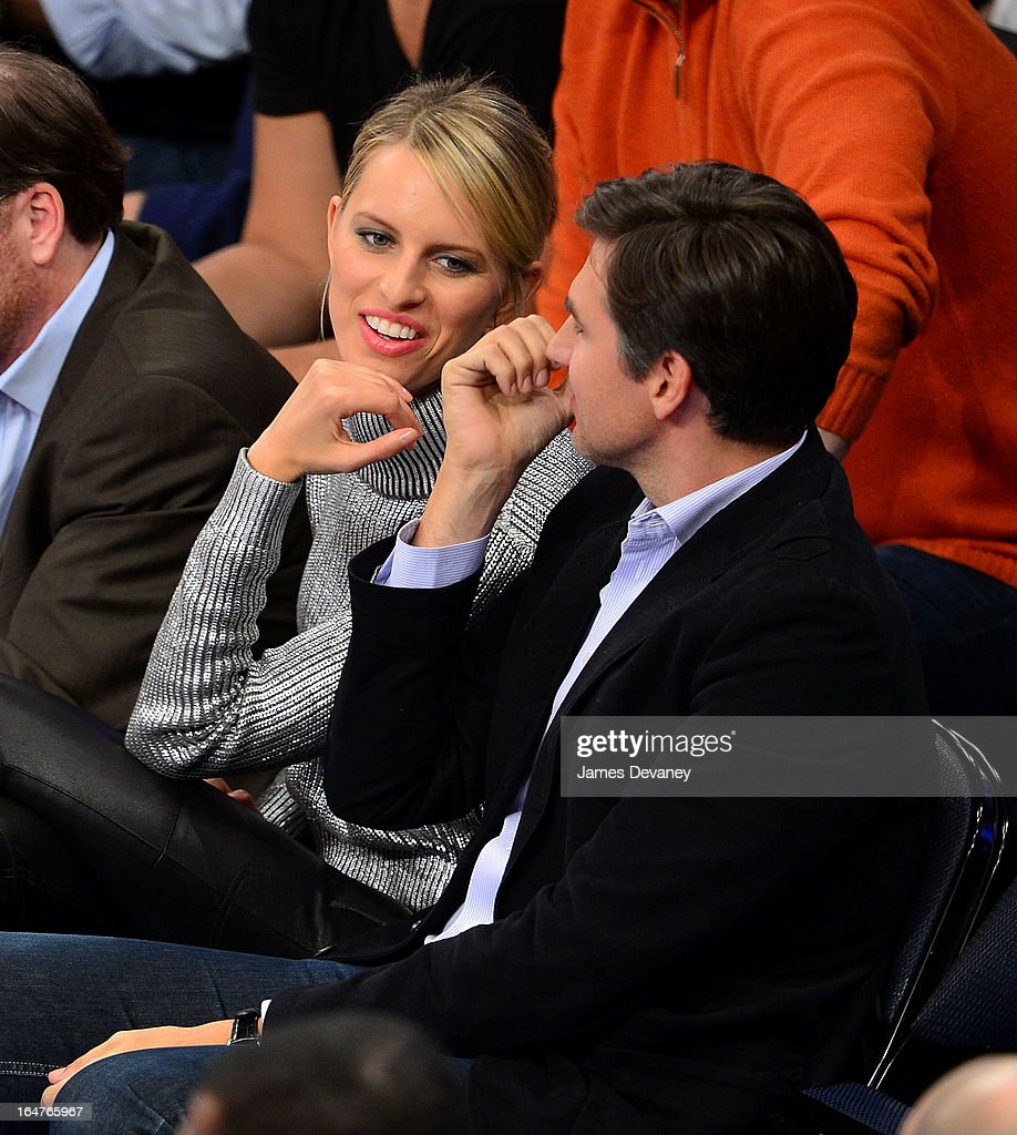 Karolina Kurkova and Archie Drury attend the Memphis Grizzlies vs New York Knicks game at Madison Square Garden on March 27, 2013 in New York City.