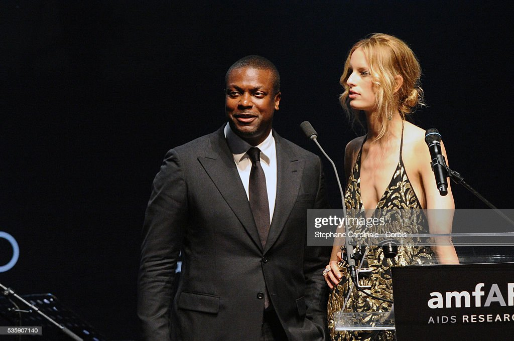 Karolina Kurkova and Chris Tucker attend the '2010 amfAR's Cinema Against AIDS Gala'