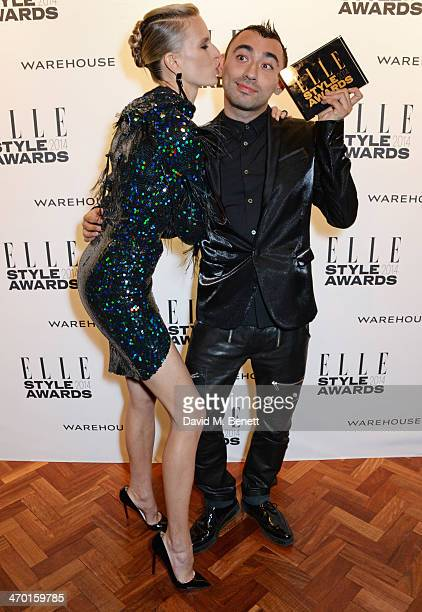 Karolina Kurkova and Nicola Formichetti winner of Fashion Innovator pose in the winners room at the Elle Style Awards 2014 at One Embankment on...