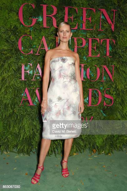 Karolina Kurkova attends the Green Carpet Fashion Awards Italia wearing Salvatore Ferragamo for the Green Carpet Challenge at Teatro Alla Scala on...