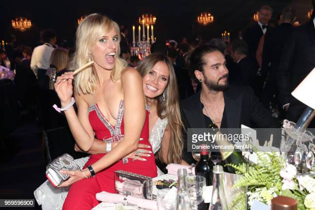 Karolina Kurkova Heidi Klum and Tom Kaulitz attend the amfAR Gala Cannes 2018 dinner at Hotel du CapEdenRoc on May 17 2018 in Cap d'Antibes France