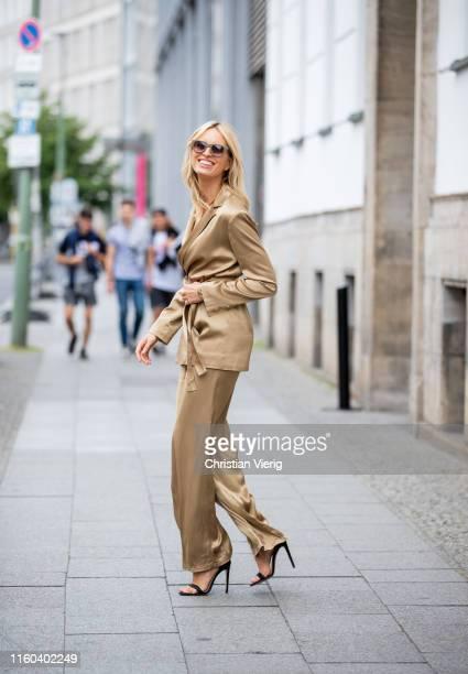 Karolina Kurkova is seen on her way to Vogue Salon wearing light brown suit Bally bag during Berlin Fashion Week on July 05 2019 in Berlin Germany